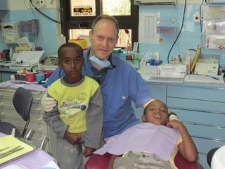Dr. Dubowsky Volunteers at AFDVI Clinic